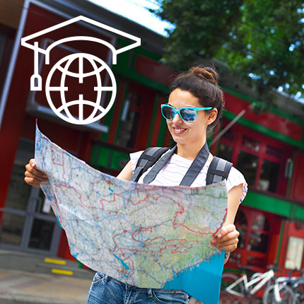 Female student reading a map with colorful sunglasses on