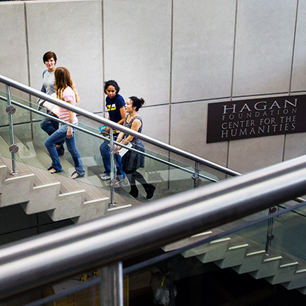 Students walking up the stairs to the Hagan Foundation Center inside the Library